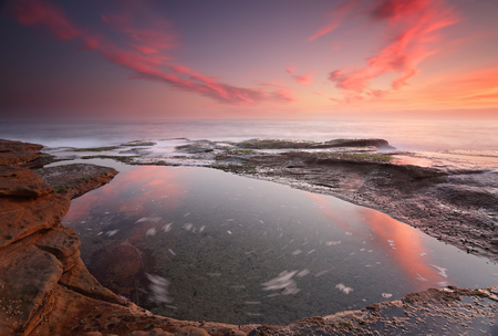 seaside: Sunrise from the coast at Coogee, Sydney Australia with motion in water