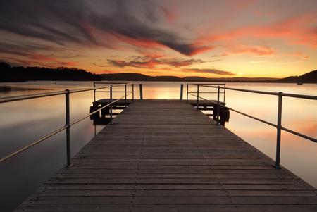balmy: Stunning sunset full of warm vivid colour on a balmy summer evening from Carak Wharf in beautiful Australia Stock Photo