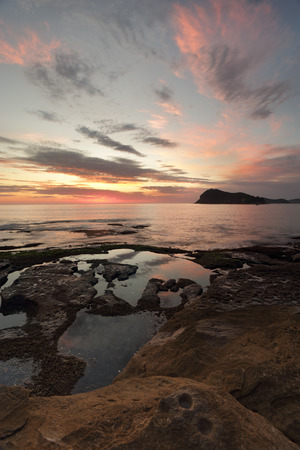Portrait views to Lion Island from Green Point, Pearl Beach just before sunrise.