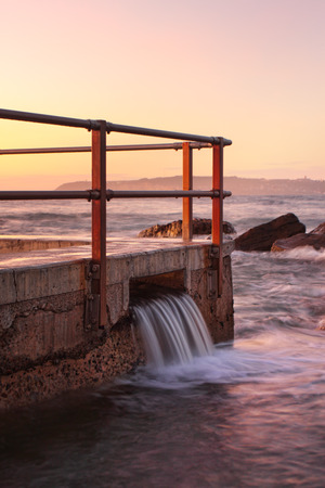 overflow: North Curl Curl rock pool overflow just before the sunrise