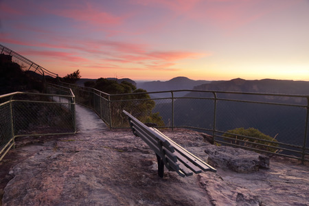 bushwalk: Spectacular dawn skies overhead with views from Pulpit Rock, Blackheath, stunning scenery and views overlooking the Grose Valley with Mount Baniks directly ahead in the far distance. This seat awaits you!