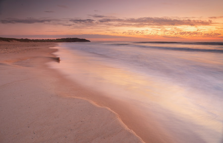 sunrise ocean: Beautiful pastel shades in the sands and water wash over this 4 second exposure at dawn sunrise, near Dee Why Lagoon and Long Reef Beach, Collaroy