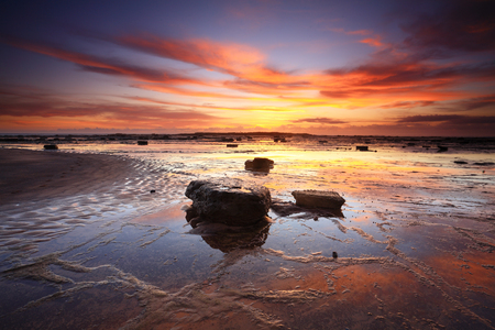 Vivid sunrise and reflections across Long Reef in Sydneys Northern beaches, Australia