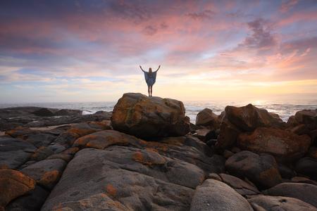 distinct: Sunrise Salute, beautiful skies and distinct orange red rocks at Eurobodalla National Park