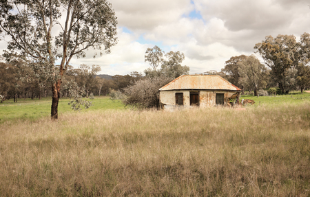 Dilapidated Australiana bush homestead forgotton over time and gradually crumbling and falling into disrepair