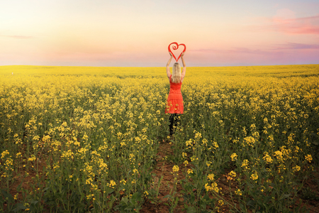 as far as the eye can see: Loving springtime in Young, Hilltops Region, Country NSW.  Standing with a red heart in flowering canola as far as the eye can see