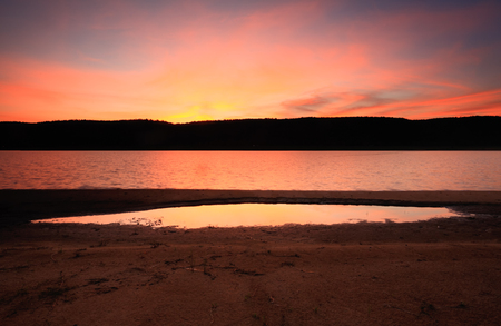 eventide: Vivid colours after sunset in the sky at Lake Burralow in Penrith Castlereagh Stock Photo