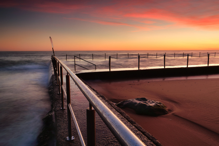 prety: Lovely spring sunrise over Newport beach rock pool Stock Photo