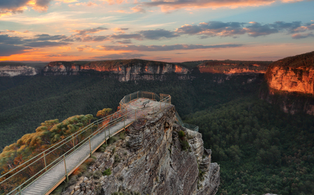 Early morning skies over Pulpit Rock Lookout a multi tiered lookout that descends from the main escarpment onto a sliver of rock that juts out into the Grose Valley. Amazing 180 degree views.   Location Blackheath Blue Mountains Australia