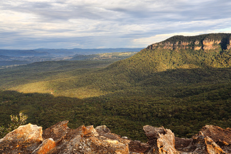 Beautiful views.  Morning light streams into the Megalong Valley just after sunrise.  Blue Mountains Australia Stock Photo