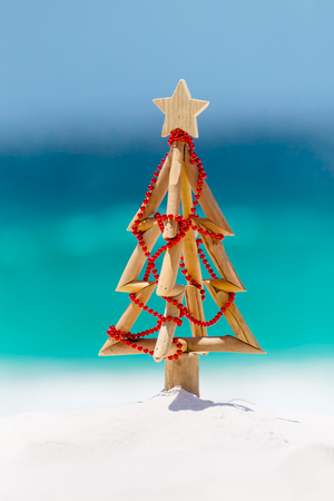 Christmas tree made of driftwood by the beach Stock Photo