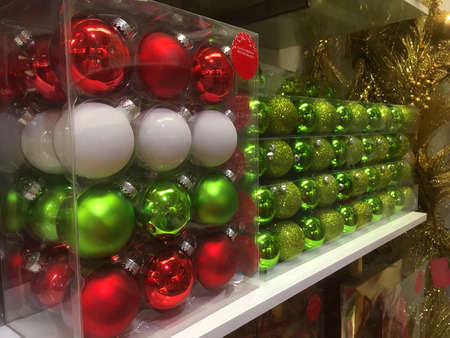 Boxes of glass Christmas tree bauble decorations ready for sale in a store