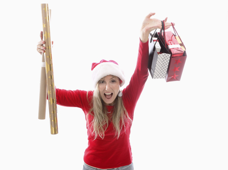 A woman holding Christmas gifts bought at the shop and gold and kraft wrapping paper Stock Photo