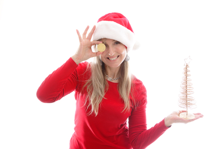 A woman holding a golden bitcoin and a golden Christmas tree in the other hand, or place another item in her hand eg a stack of coins Stock Photo
