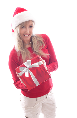 A woman holding a red wrapped Christmas present tied up with silver ribbon. Stock Photo
