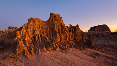 Landforms sculpted by wind and rain over time in the arid desert of Australia Stock Photo