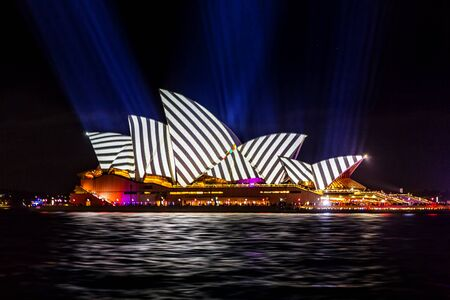Sydney, Australia - May 25, 2018;  Sydney Opera House lit with vibrant colours geomeric patterns and motion graphics during the Annual Vivid Sydney celebrations