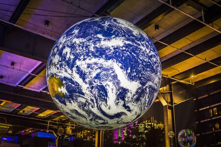 Sydney, Australia - May 25, 2018;  Earth is a large 3.75 metre installation that hangs from the ceiling and  incorporates nasa imagery and cosmic sounds to allow viewers an experience like that of the astronauts