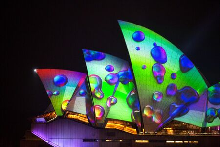 Sydney, Australia - May 29, 2018;  Sydney Opera House illuminated with beautiful vibrant imager, bold colours and coloured rain drops one of the many motion images  during the annual Vivid Sydney celebrations Éditoriale
