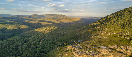 Panoramic vista of the Blue Mountains with dappled light across the hills and valleys