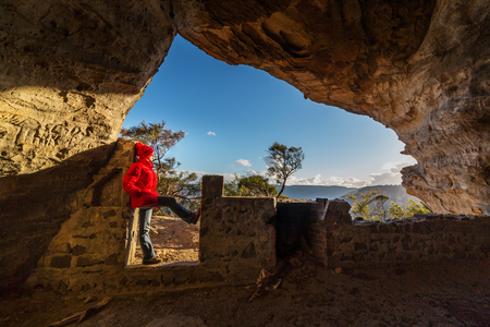 Standing in a cave at cliff edge in the upper Blue Mountains Australia