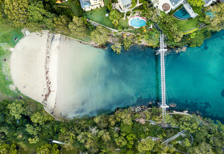 Parsley Bay beach and park with its pedestrian bridge on Sydney's south head.