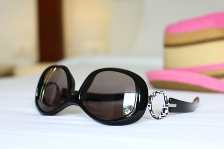 oversized: Oversized sunglasses are popular with ladies as offer more area of protection to the sun. Stock Photo