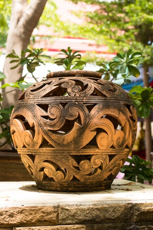 coatings: A clay pot is placed outdoor, and adhered by stains. Stock Photo