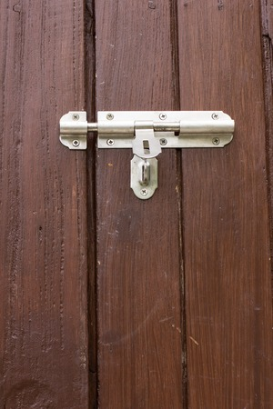 This door lock is to prevent disallowed access. Stock Photo