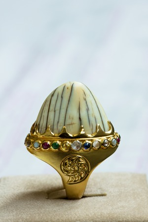 believed: A ring with nine different colored gemstones. It is believed to be prosperous to the wearer.