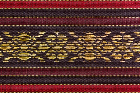 dimond: A beautiful piece of very fine Thai silk of stripes on both edges, with dimond shaped design at the center.