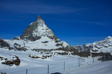 prominence: The close view of the well-known Matterhorn at Trockener Steg, a minor prominence that lies at a height of 2,939 meters above sea level. Stock Photo