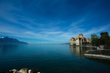 chillon: Chateau de Chillon on lakeside of the Lake Geneva on a shiny day. The photograph is taken at Chateau de Chillon boat transfer point.