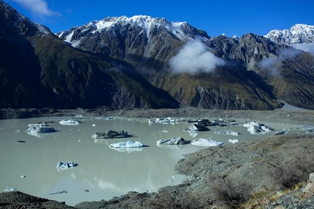 aoraki mount cook national park: The Tasman Lake in the fall, is with large ice cubes that are loosen from the Tasman Glacier of Aoraki Mount Cook National Park in New Zealand.
