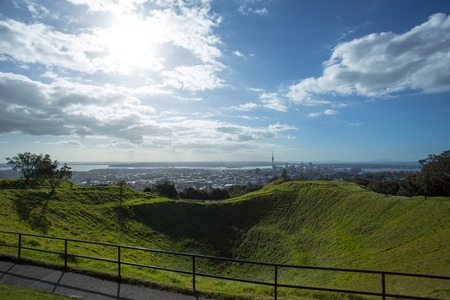eden: Mount Eden is a volcanic cone located in Auckland of New Zealand. The downtown Auckland and Shoal Bay is seen in the distance. Stock Photo