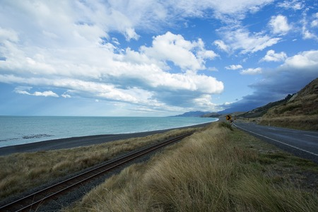 ridge of wave: The East Coast near Kaikoura of the South Island of New Zealand, has a great view of parallel lines of the road and rail along the south Pacific ocean.