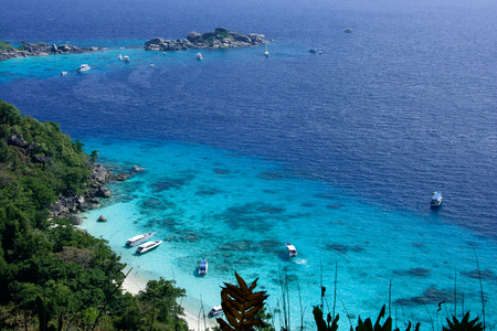 speedboats: Similan Islands in Andaman Sea of Thailand, are known as the place of clear blue water and diving. Speedboats take tourists to shallow sea for snorkelling. Diving boats take divers to deeper sea for scuba diving.