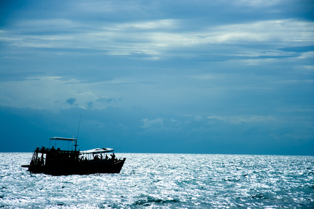 A scuba diving boat, is moving to next diving site after its afternoon break. This one-day boat provides a saloon where divers take a rest above its control room. Standard-Bild