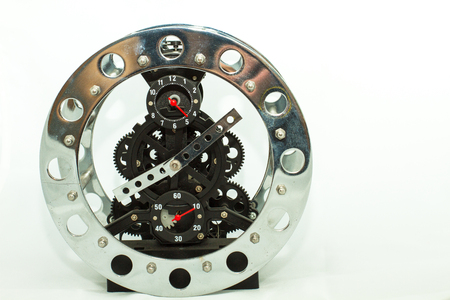 The clock is uncovered, displaying its mechanism. This type of exposure is also called the skeleton. Standard-Bild