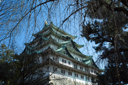 The castle of Nagoya was built over 400 years ago. The castle has been rebuilt recently, but preserved as it was. There is a golden dolphin couples on the rooftop.