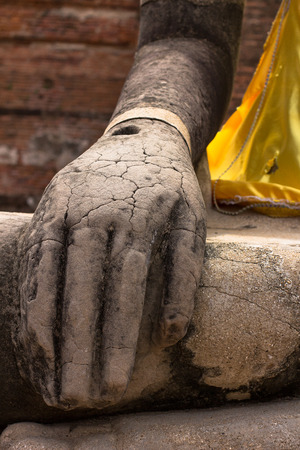 Lord Buddha placing hands on the laps, is part of composing for meditation. The Buddha statue is respectfully engaged placed at an ancient temple that was built over 600 years ago in Thailand's ancient capital of Ayutthaya.