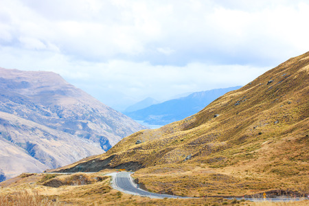 The Crown Range Summit Pass, is New Zealand's highest sealed road. The road is a major tourist route between Wanaka and Queenstown. Lake Wakatipu, the lake in Queenstown is seen from the distance.