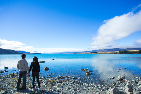 tekapo: Lake Tekapo has a beautiful blue color that caused by glacial flour, fine rock particles crushed by glaciers. The lake is located at the center of the South Island of New Zealand.