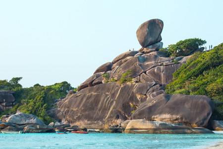 Similans, are a group of nine islands in Andaman sea of southern Thailand. The Similans are famous in distinctive blue water, and diving sites. The sailing rock is the site to watch the sunset. Standard-Bild