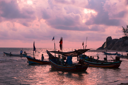 Fishing boats are head out the sea, going fishing at dawn. These boats are near-shore types, that return the mainland in the morning. The boats are long-tailed, that common automotive engines drive them through long driveshafts, attached by propellers.