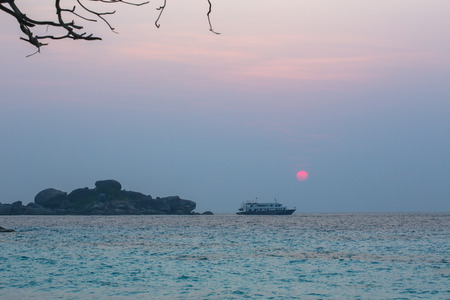 A cruise ship stopovers offshore of the Similan-Miang Island. This cruise ship voyages its passengers in the Andaman sea of south Thailand. The voyage includes beach tour, swimming and diving.  The Similan-Miang is one of a group of nine  islands.