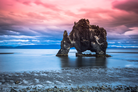Hvitserkur troll rock, is a 15 meter high basalt stack located off the shore of north-west Iceland. The stack has the appearance of a dragon, or elephant drinking sea water in Vatnsnes peninsula.