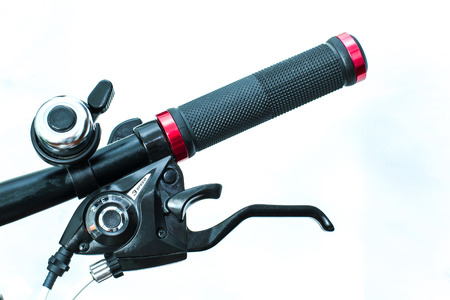 silver bars: A brake lever integrated with 3-speed shifter, are mounted on a bikes handlebar. An alloy bell is mounted adjacent to the brake lever, allows the biker rings the bell without handing off the grip.