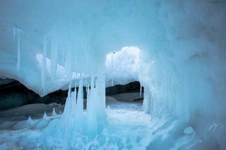 A grotto at Olkhon Island in the Lake Baikal, is covered by thick icicles in the winter. During the daytime, the icicles melt and extend longer at the end then refreeze when temperature drops. Standard-Bild