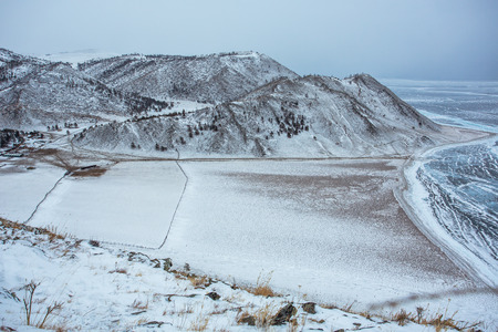 Pasture land used for livestock on the Lake Baikal of southern Siberia, becomes open ground covered with snowflakes in the winter. The lake's surface is turned into thick ice sheet, as a result of extreme cold.